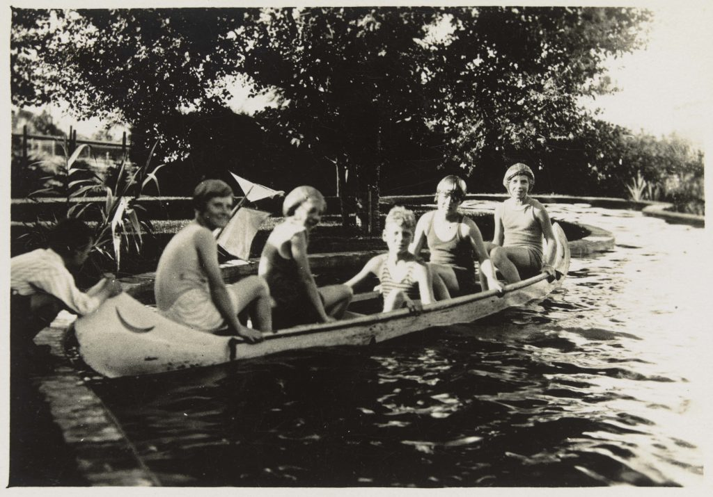 Five children in a canoe