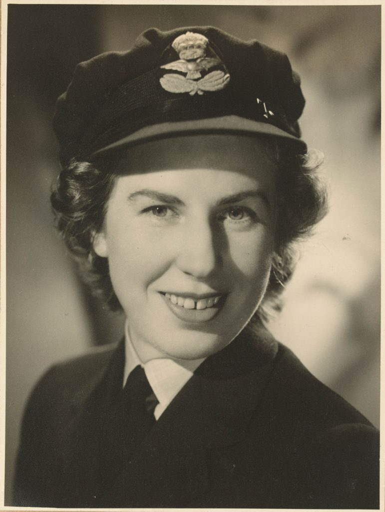Portrait (head shot) of a woman wearing Women's Auxiliary Australian Air Force Servive Uniform