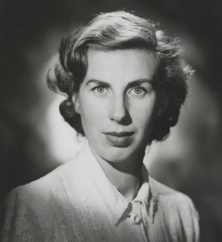 Photographic portrait of a woman with light coloured shirt