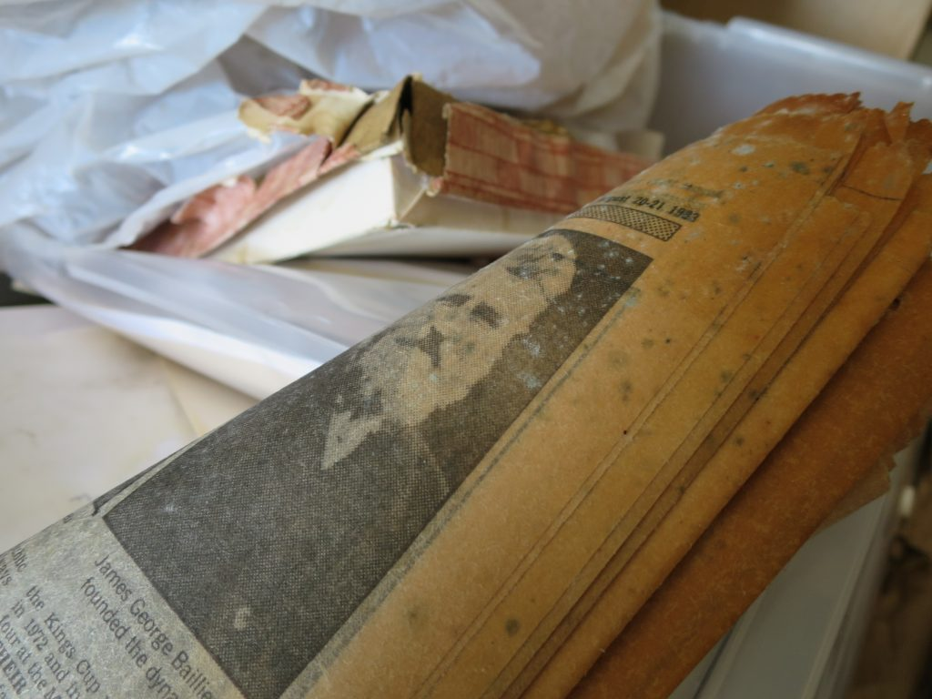 Close up image of damp and mouldy newspaper