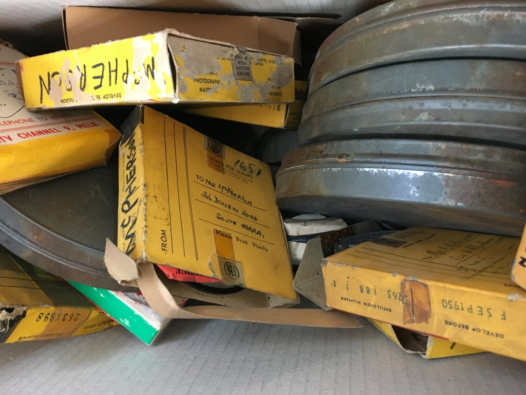 16mm film reels in original yellow cardboard boxes and metal film cans