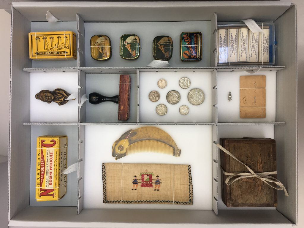 Miscellaneous small objects in archival box