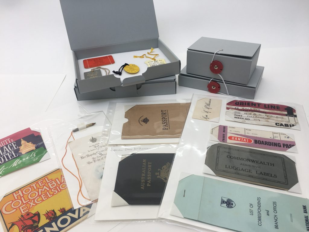 Passports and ephemera in archival sleeves and boxes