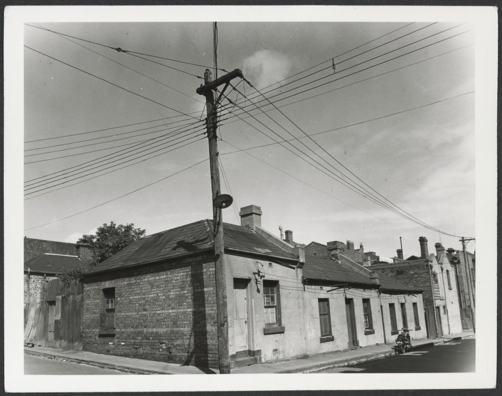 Image of run down two room cottages at the corner of Cumberland Place and Burton Street