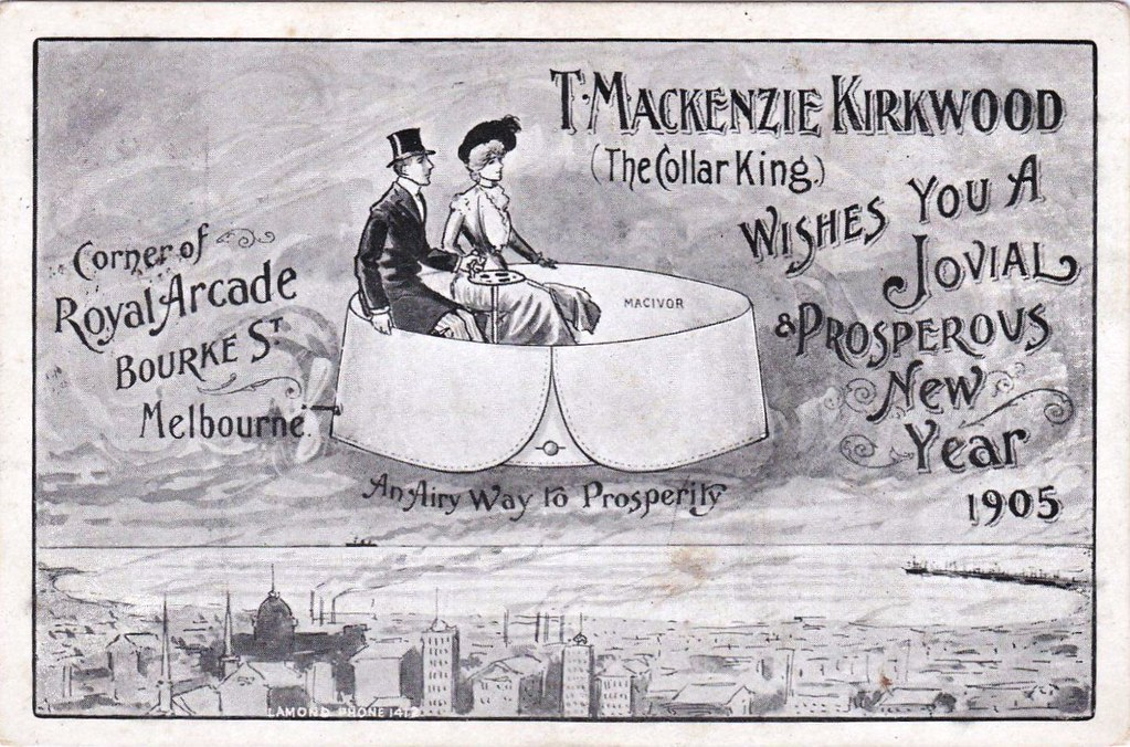 Black and white advertising postcard featuring illustration of a lady and gentleman riding over the city in a giant flying collar. The caption reads 'T. MacKenzie Kirkwood (The Collar King) wishes you a jovial prosperous New Year 1905'