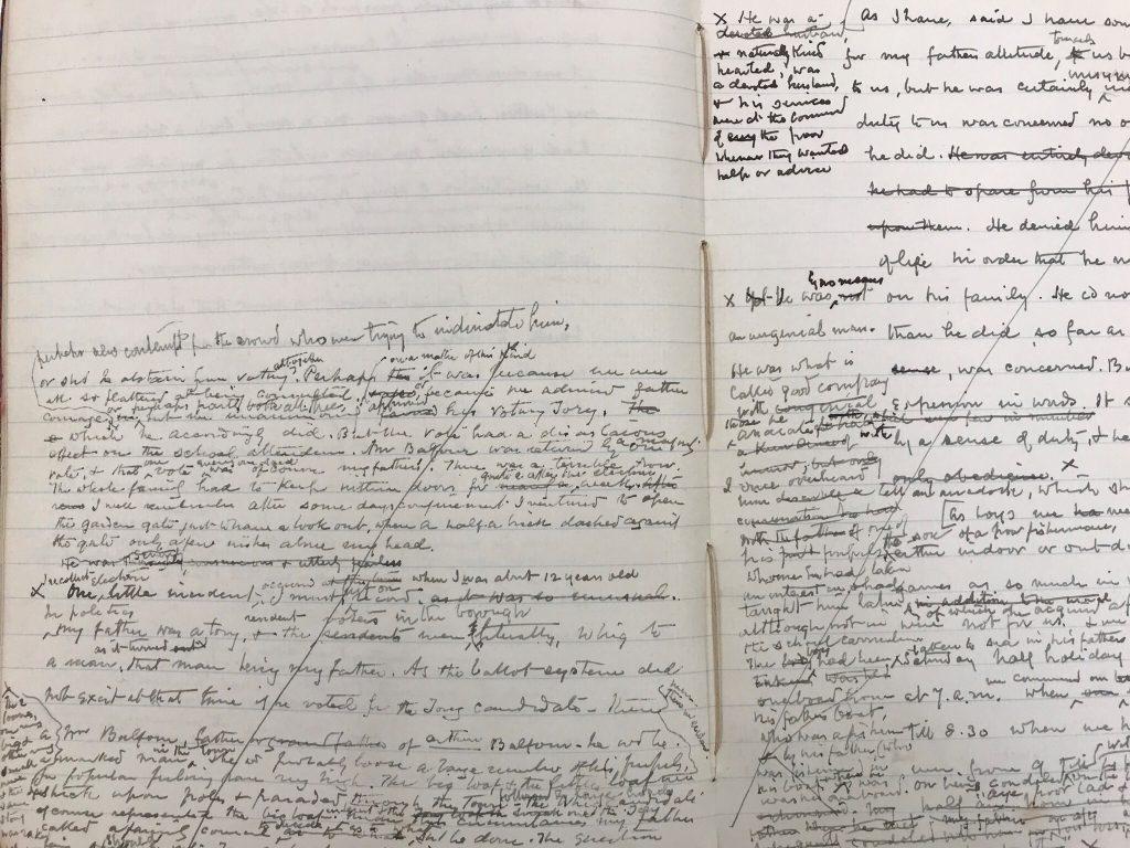 Open notebook with handwritten notes in black ink