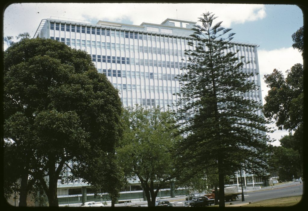 Colour photo of the exterior of the Commonwealth building in Spring Street circa 1950 - 1971
