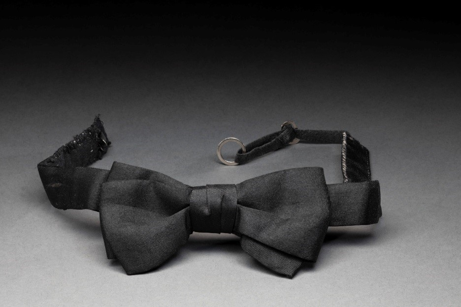 Black and white photo of black silk bow tie
