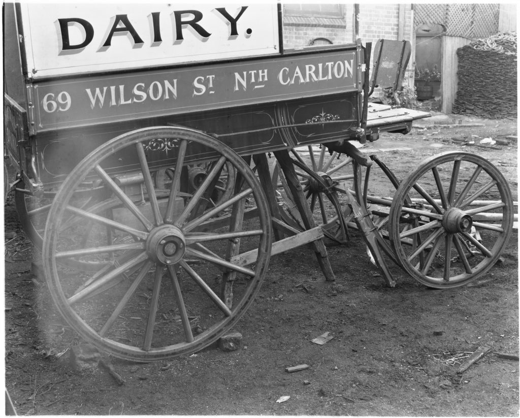 Black and white photo of dairy wagon