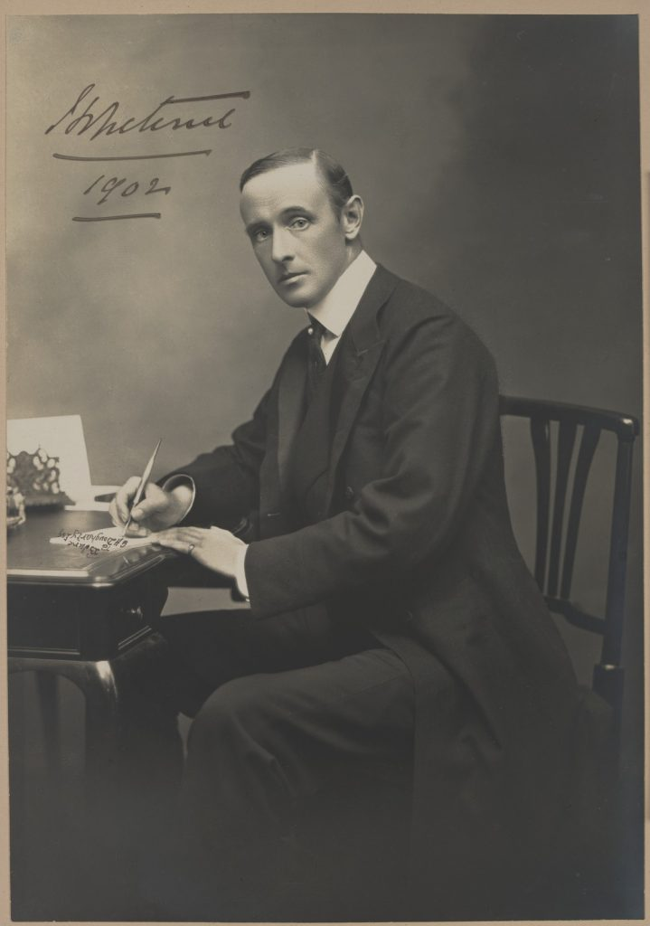 Black and white photo of Earl Hopetoun at his writing desk