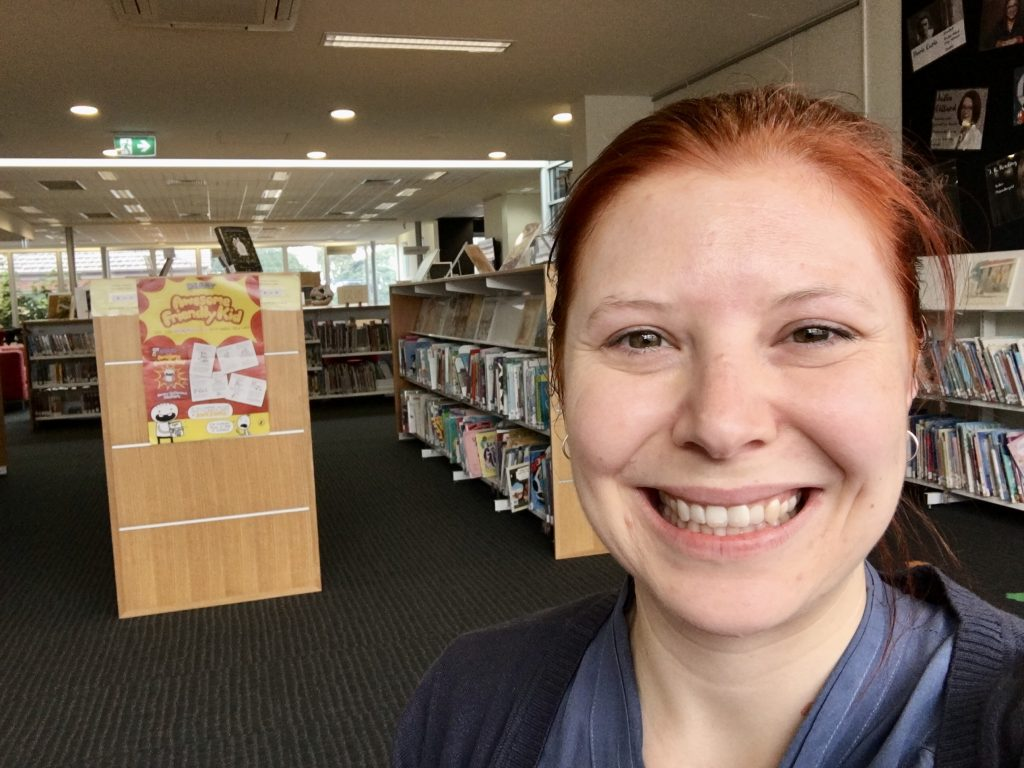 Portrait of woman in front of Library shelf