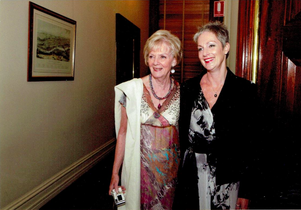 Two women dressed formally