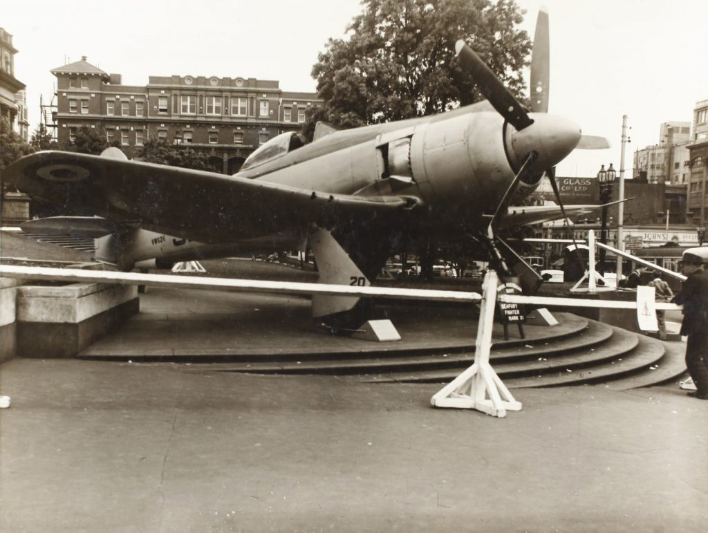 Black and white photo close up of Sea Fury aircraft on Library steps