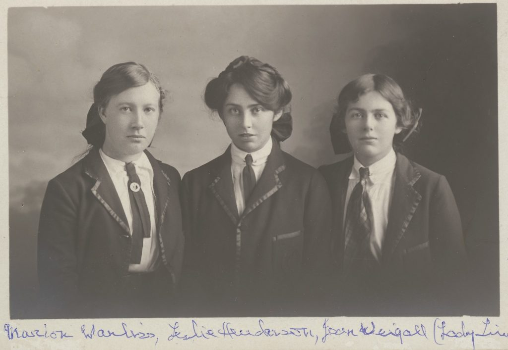 Black and white photo of Marion Boyd Wanliss, Leslie Moira Henderson and Joan a'Beckett as teenagers in school uniforms