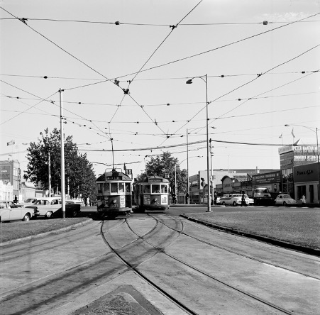 W-class trams travelling through junction at Elizabeth Street and Flemington Road, Melbourne.