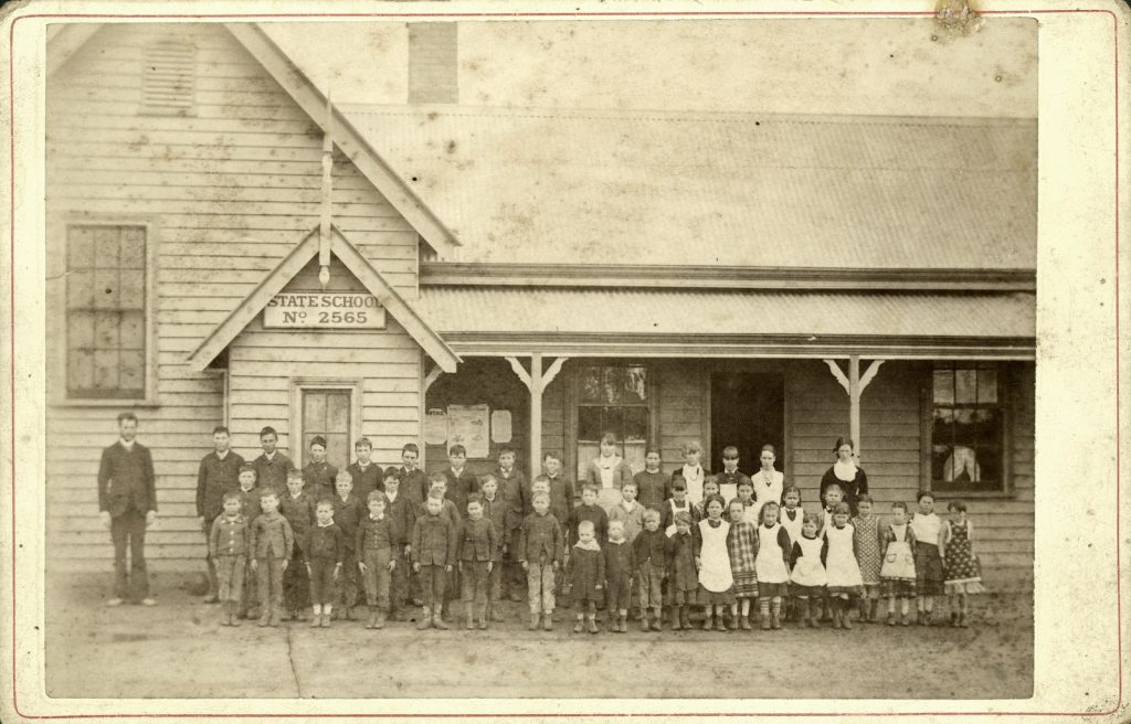 School assembled outside school house