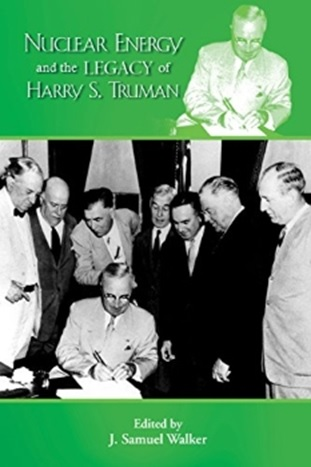 Front cover image depicts President Truman signing the atomic energy bill, August 1, 1946.