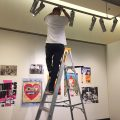 Perfecting the lighting of a series of exhibition prints during installation