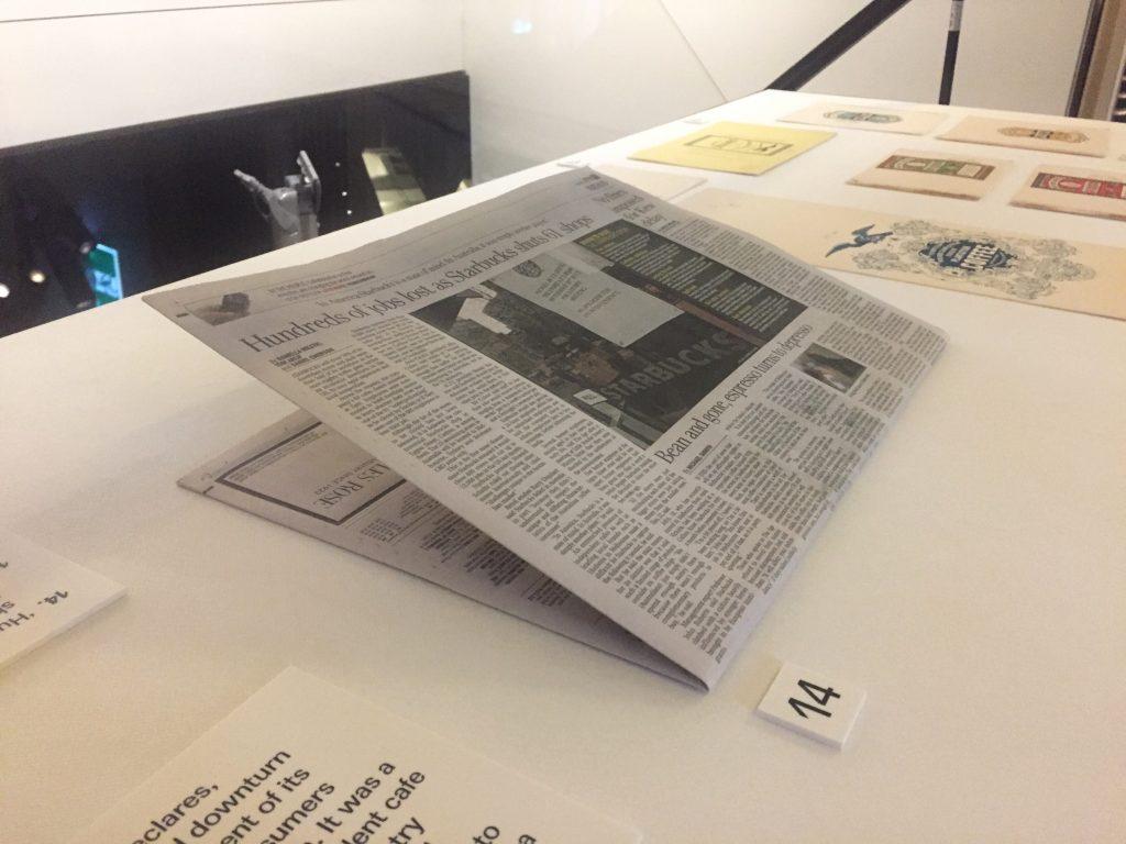 Newspaper folded in half installed in a showcase