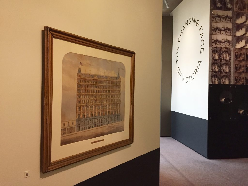 View of entry to exhibition with framed artwork on the wall