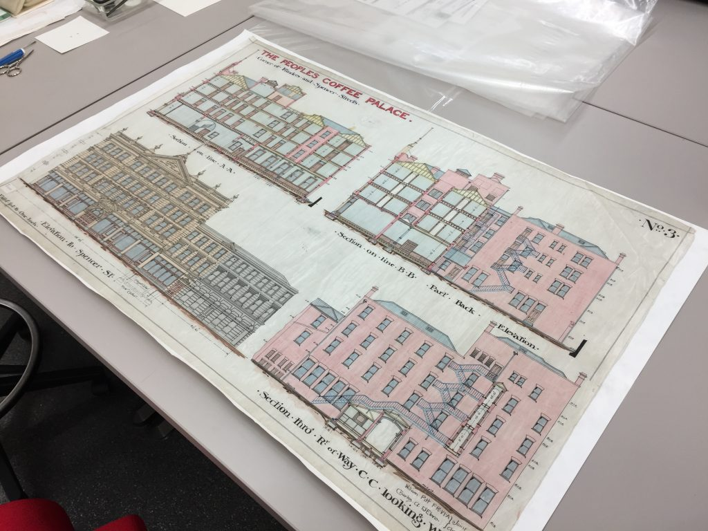 Front view of an architectural drawing on tracing cloth being conserved in the Conservation Lab
