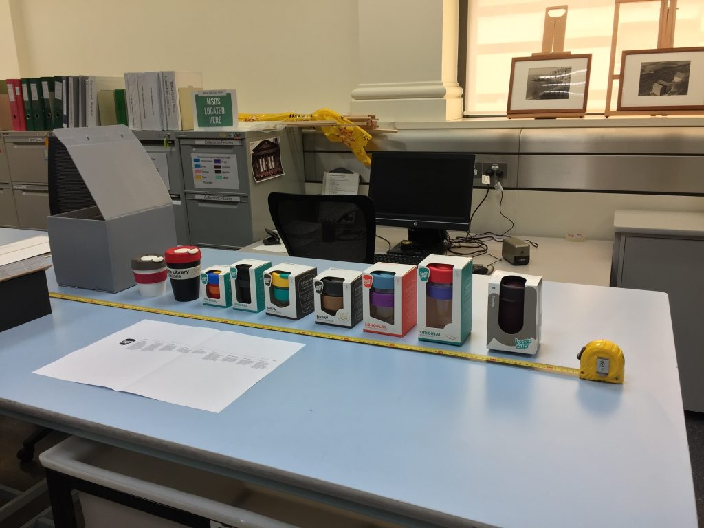 Row of Keep Cups on a work bench being measured for display