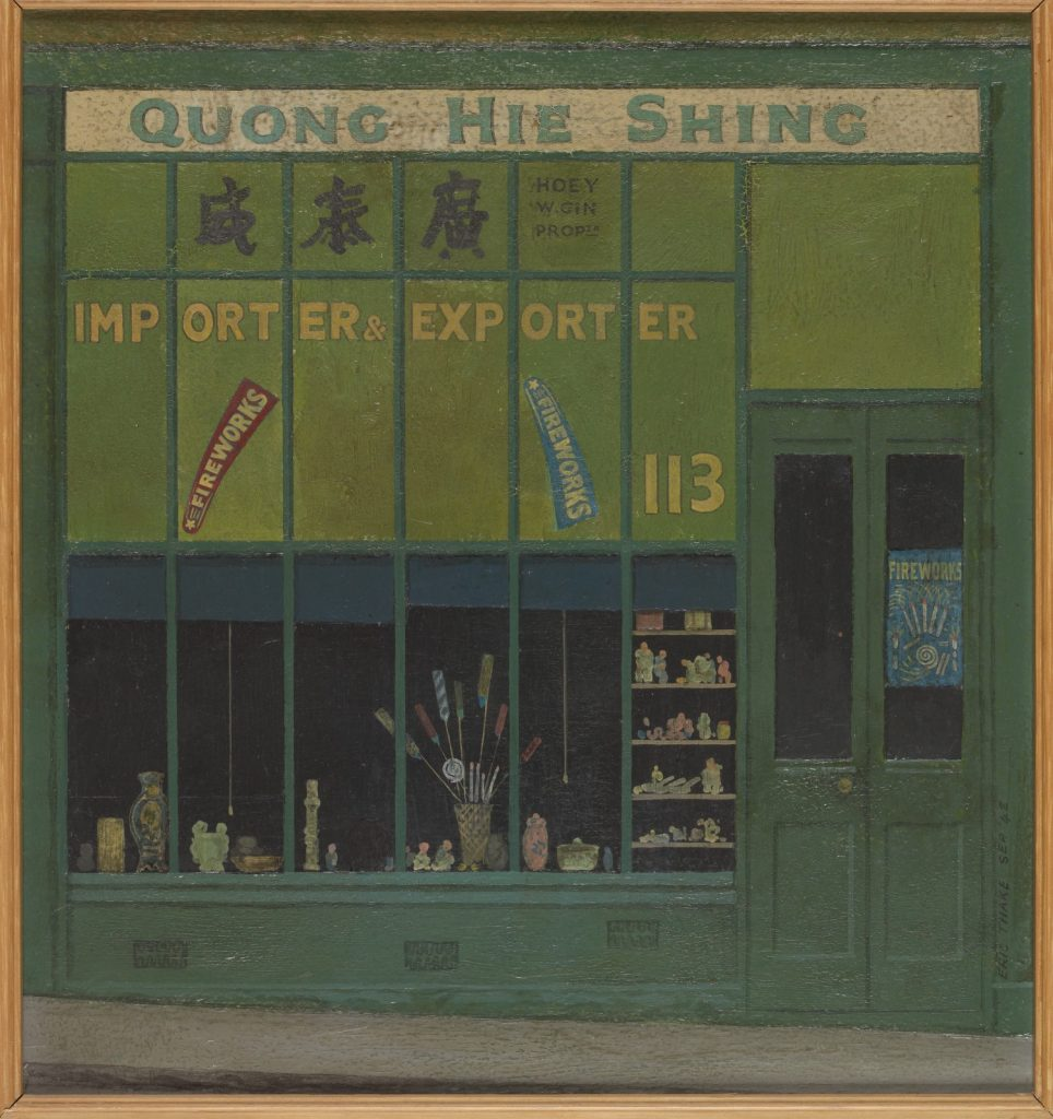 Painting predominantly in green colous of Chinese shopfront. Number 113 is painted next to the door, and sign over shop reads 'Quong Hie Shing. Impirter and exporter'. There are also signs advertising fireworks, and pictures of colourful lollipops and statuettes in window