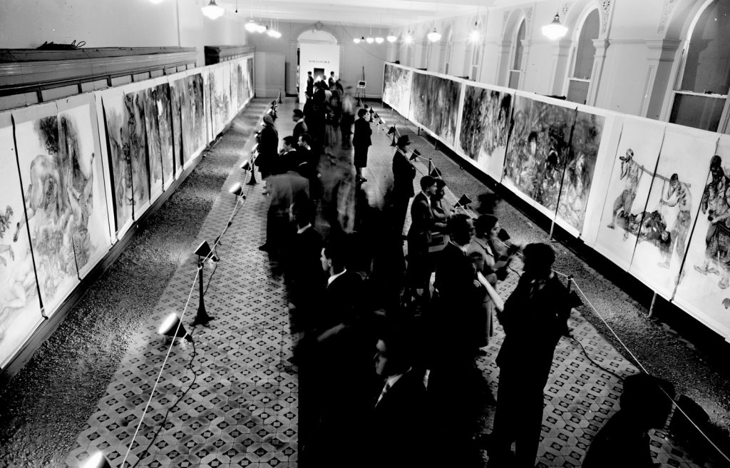Black and white image showing people viewing Hiroshima Panels, Stawell Gallery