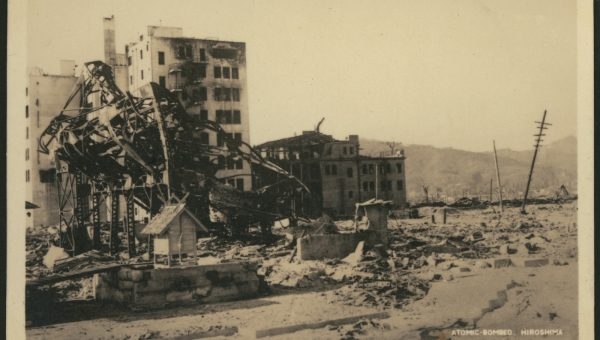 A sepia photograph showing ruined buildings in Hiroshima after the nuclear bomb was dropped in 1945.