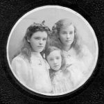 Three young girls with long hair wearing white shirts in circular mount