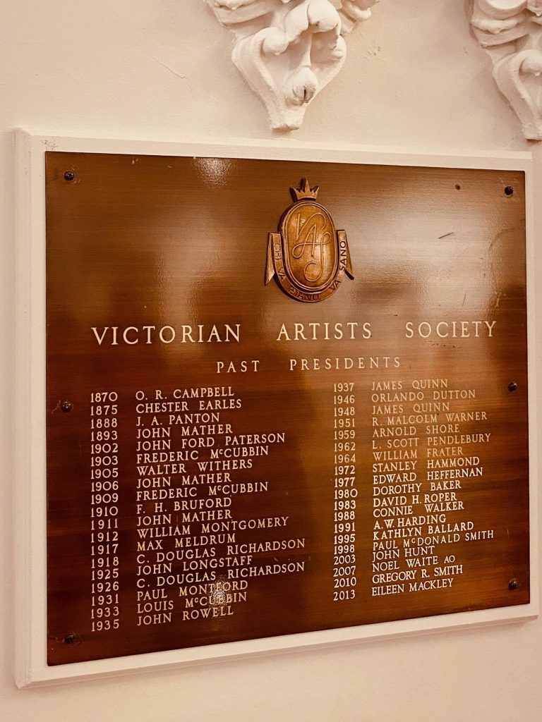 Colour photo of plaque on the wall at the Victorian Artists' Society listing the names of past presidents