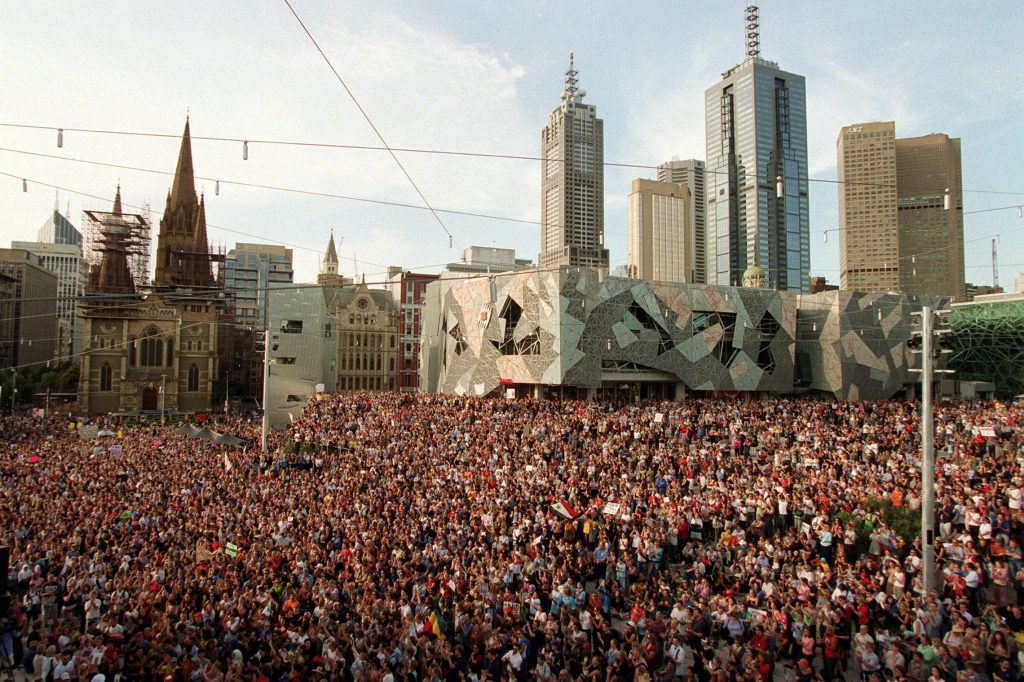 Crowd scene of a peace rally at Federation Square