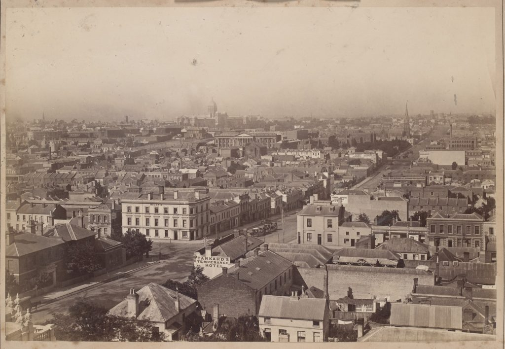 Black and white photo depicts panoramic view of Melbourne city