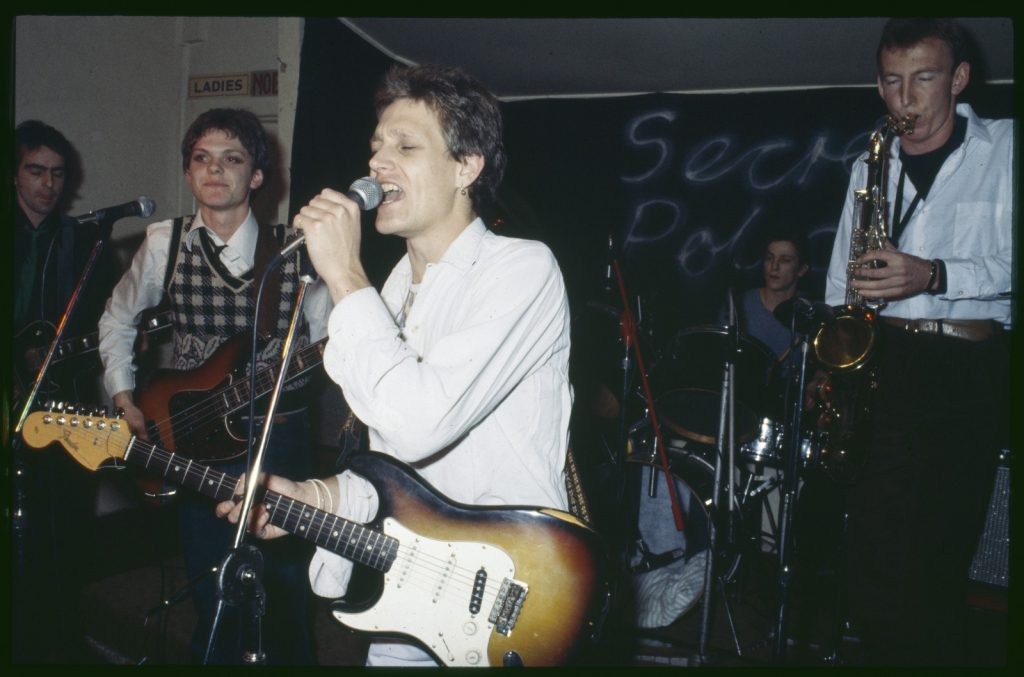 Photo of the musical band Secret Police. The 'Roger' in question is lead singer Roger Wells.