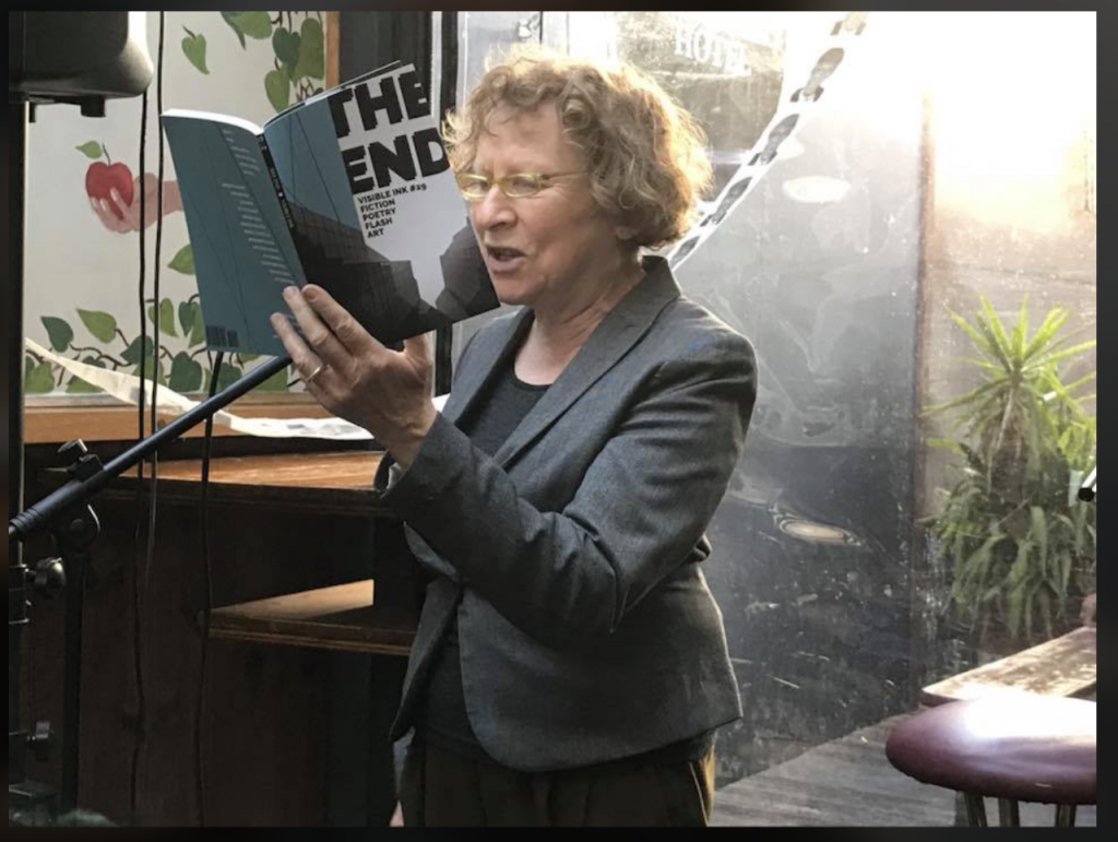 Ania Walwicz reading from a book into a microphone