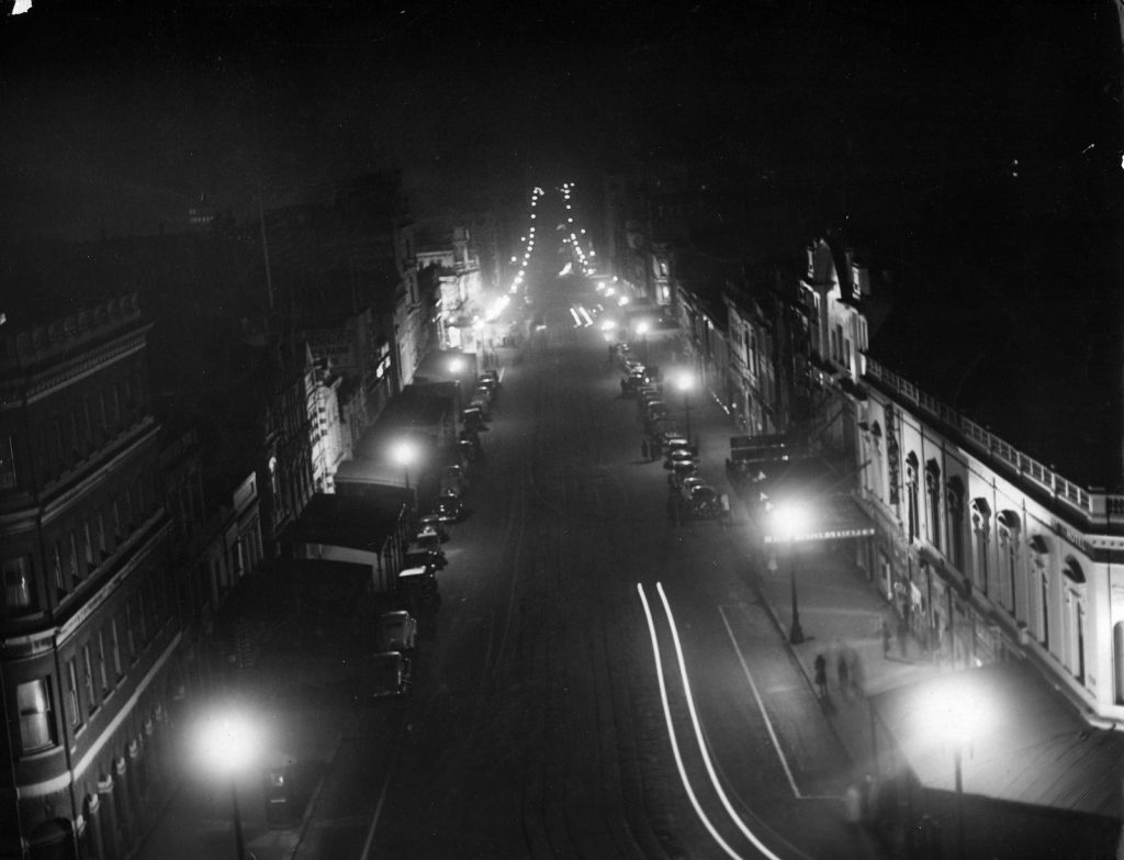 Shows a view down Bourke St. during a blackout.