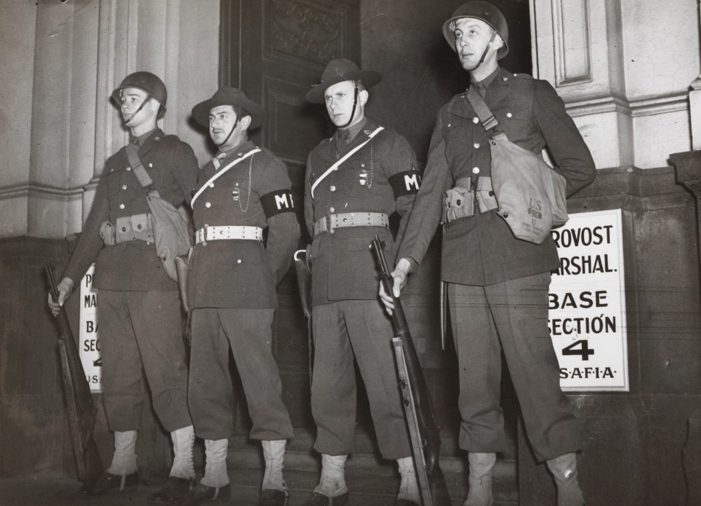Military guard outside court.