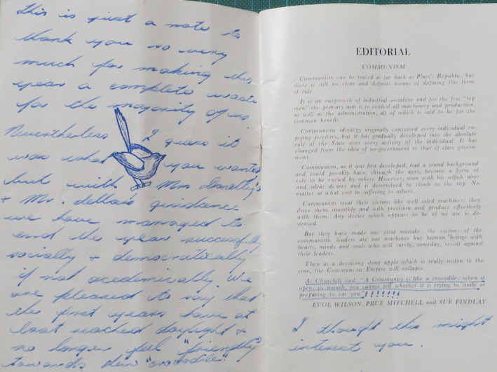 Inside cover of 'The Wren' showing editorial titled 'communism' and handwritten student message.