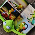 Kermit reads a book about frogs